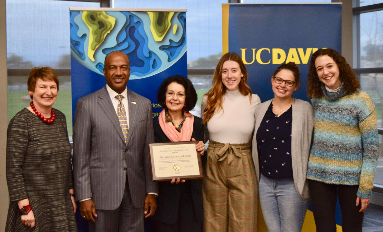 Margherita Heyer-Cᰵt with Chancellor Gary S. May, Vice Provost and Associate Chancellor Johanna Reglulska ,and three nominating students, from left to right, Catherine Charles, Taylor Morgan and Beatrice Paolucci, at the Excellence in the Teaching of Study Abroad Award ceremony, UC Davis International Center, March 7, 2019